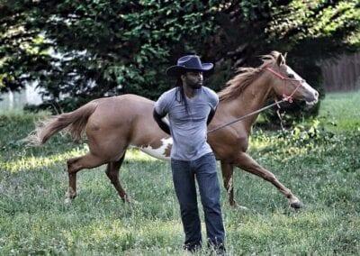 Jadon Relaford next to Horse